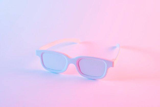 White eye glasses against pink background