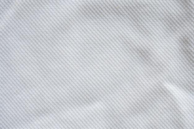 Белая ткань спортивной одежды джерси текстуры фона