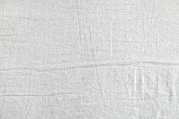 白い布のテクスチャー。服の背景。閉じる