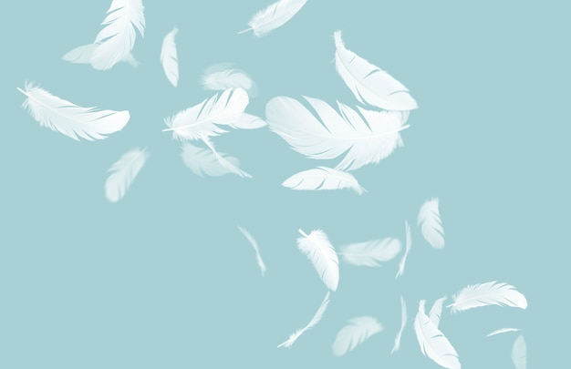 White feathers floating in the air on blue pastel background
