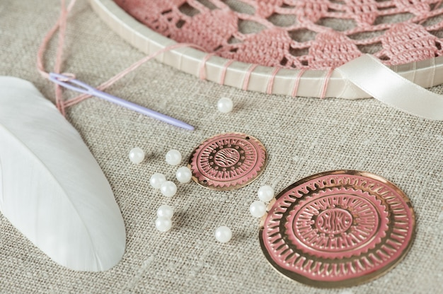 White feathers, pearls, pink beads