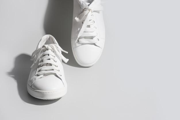White female gumshoes on grey background