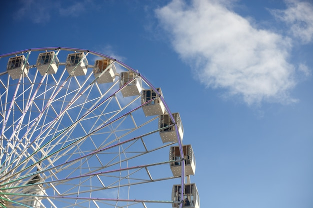 White ferris wheel over blue sky in the sunny day