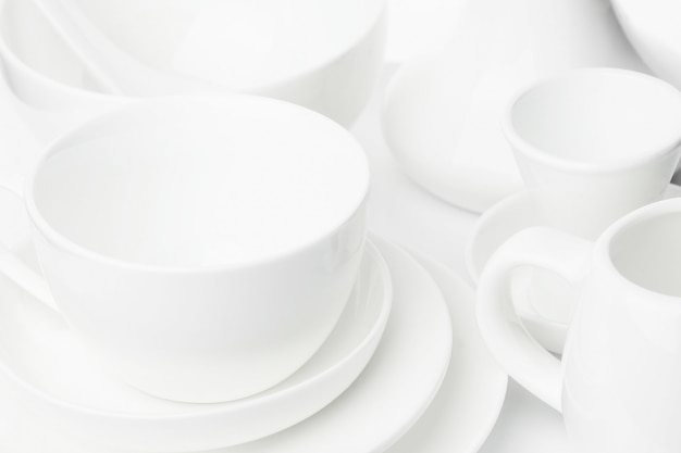 White festive dishes of different sizes and shapes, on a white background.