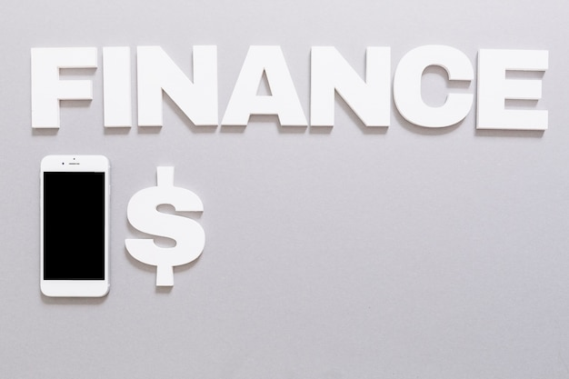 White finance word with dollar sign and smartphone on gray background