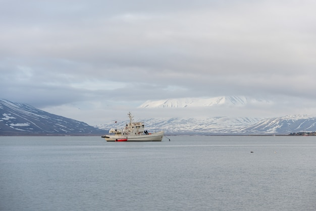 White fishing vessel at anchor