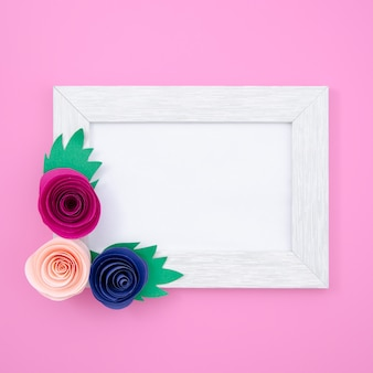 White floral frame on pink background