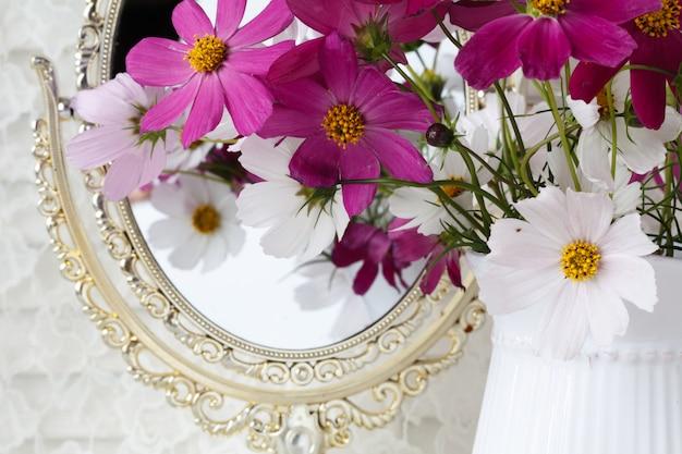 White flower bouquet in ceramic vase. wedding decoration.