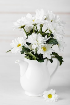 White flowers arrangement in white vase