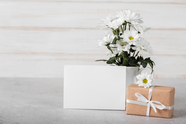White flowers arrangement with empty card