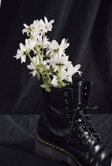White flowers in dark boot