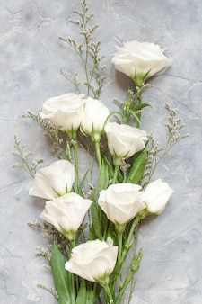 White flowers on a grey background top view