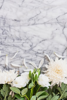 White flowers on marble tabletop