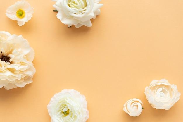 White flowers pattern on orange background