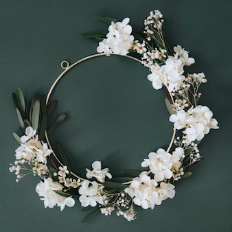 White flowers on round gold frame