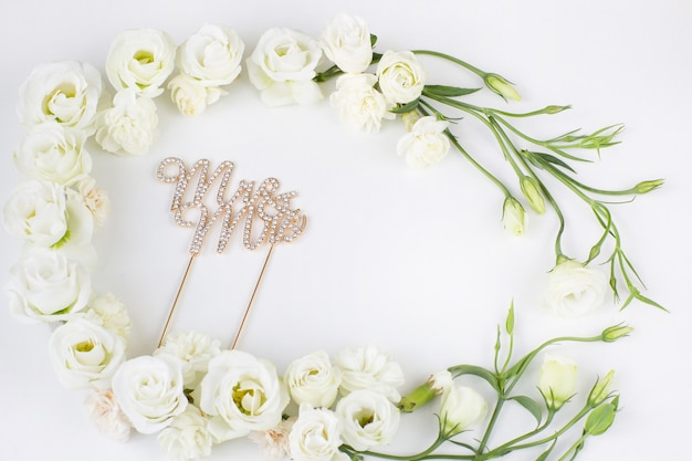 White flowers with a frame and the inscription mr. and mrs.