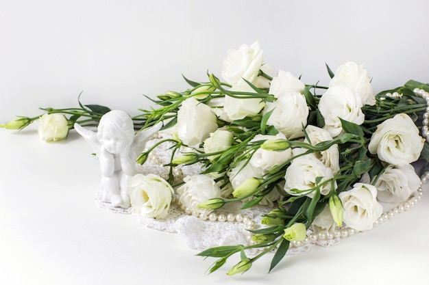 White flowers with pearl beads and a ceramic angel