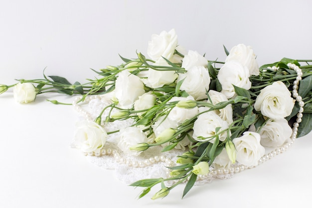 White flowers with pearl beads