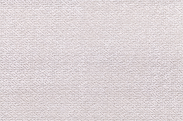White fluffy background of soft, fleecy cloth. texture of textile closeup