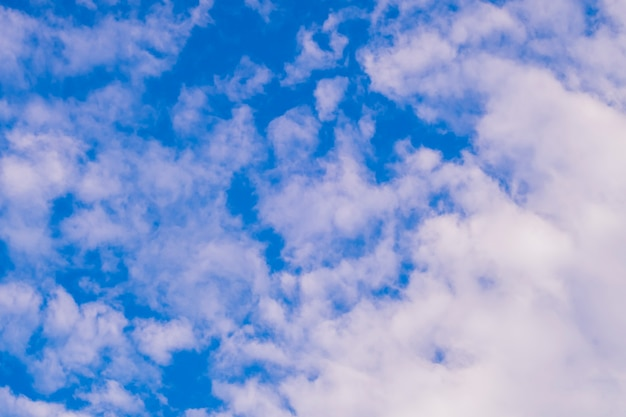 White fluffy and cirrocumulus clouds on a blue sky