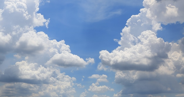 White fluffy clouds on blue sky background