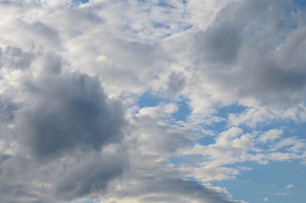 White fluffy clouds on a bright blue sky