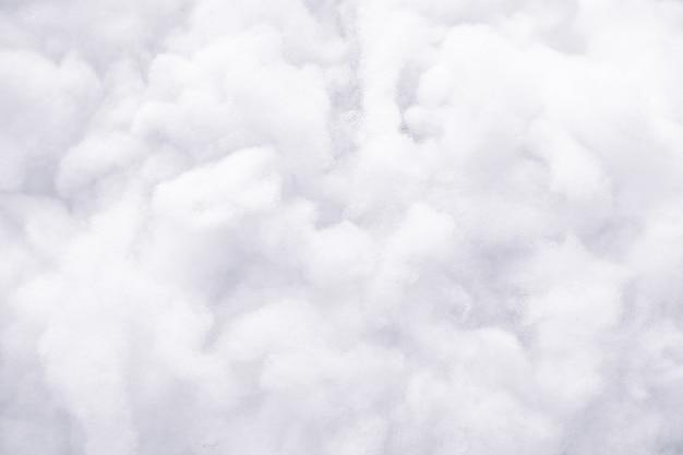 白いふわふわの綿の背景、抽象的な贅沢な詰め物の雲の質感