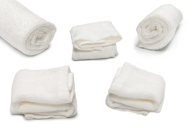 White fluffy cotton towel isolated on a white background. spa and resort.