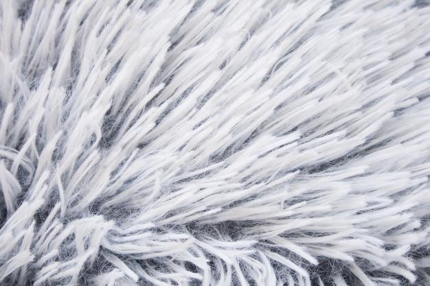 毛皮のクローズアップテクスチャーと白いふわふわの表面