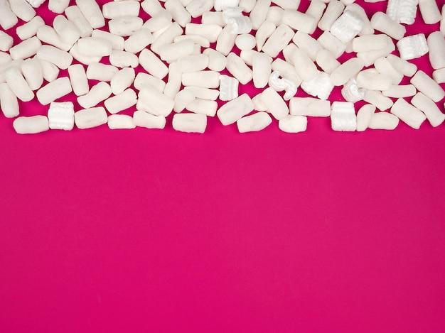 White foam filler for filling parcels during transportation on pink