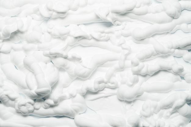白い泡のテクスチャの抽象芸術。グレーの色合いでシェービング泡効果面を適用しました。