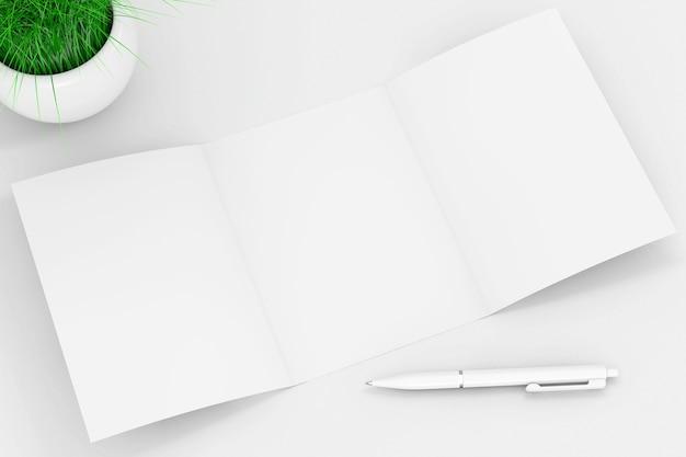 白い背景の上の白い陶磁器プランターのペンと草の近くの白い折りたたまれたモックアップパンフレット紙。 3dレンダリング