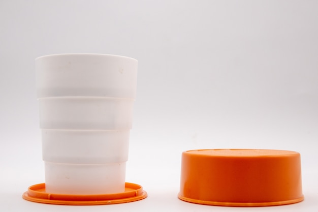 White folding plastic cup with red water cap