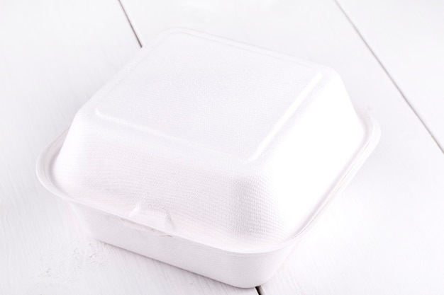 White food box, packaging for hamburger, lunch, fast food, burger, sandwich. product pack on white wooden table