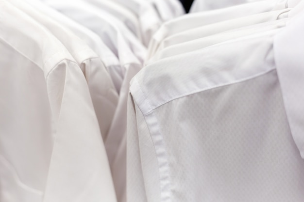 White formal shirts hanging on a hanger