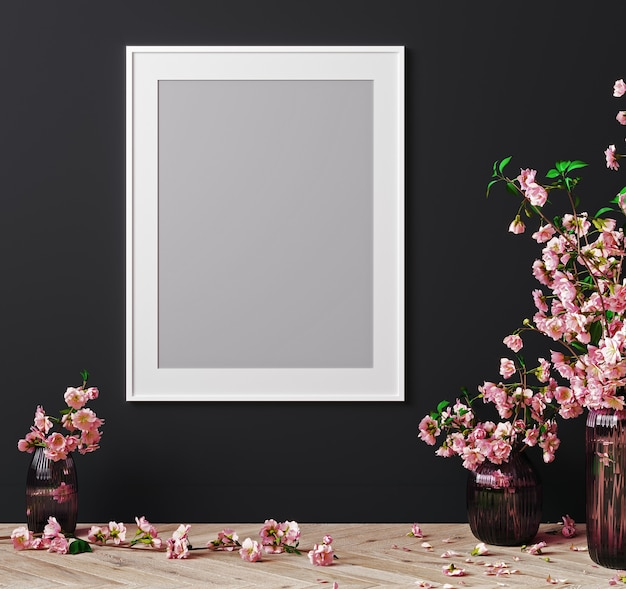 White frame on black wall in bright interior with pink flowers, sakura on wooden floor, 3d rendering