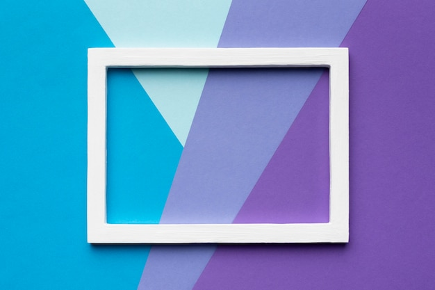 White frame on colorful background top view