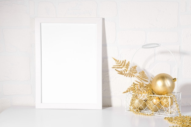 White frame mockup with christmas gold glitter baubles, gold fern, add quote, headline, or design