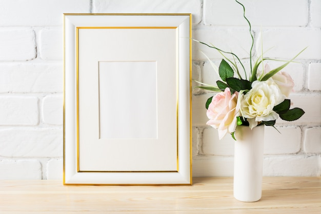 White frame mockup with pale pink roses in vase