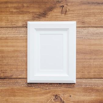 White frame on a vintage wooden background