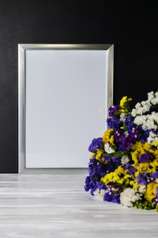 White frame with bouquet of colorful flowers copy space for text
