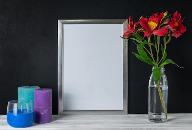 White frame with candles and alstroemeria flowers copy space for text