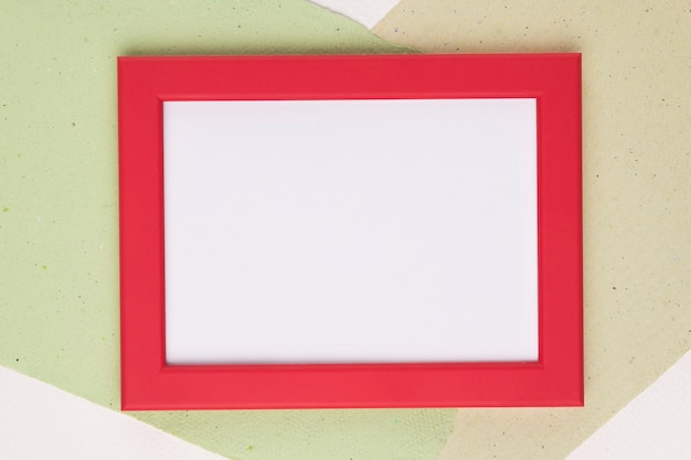 White frame with red border on paper background