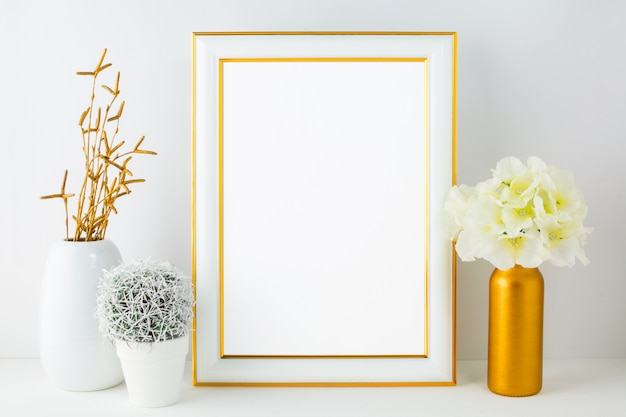 White frame  with small cactus