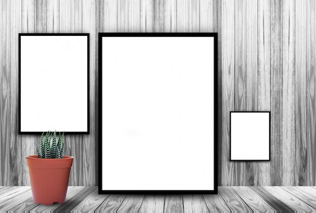 White frame on wooden wall background