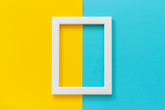 White frame on yellow and blue background