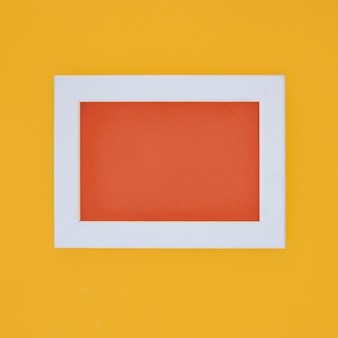 White frame in yellow wall