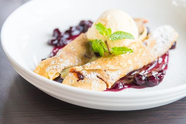 White fresh pancake blueberry raspberry cream