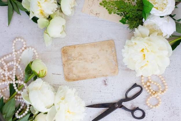 White fresh peony flowers vintage flat lay wedding frame