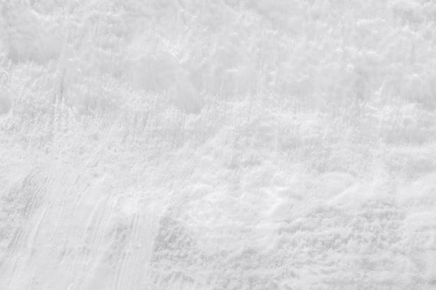白い新雪の背景または雪のテクスチャ